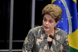 Suspended Brazilian President Dilma Rousseff delivers a speech during her testimony on the impeachment trial at National Congress in Brasilia on August 29, 2016. Rousseff arrived at the Senate to defend herself confronting her accusers in a dramatic finale to a Senate impeachment trial likely to end 13 years of leftist rule in Latin America's biggest country. / AFP PHOTO / EVARISTO SA